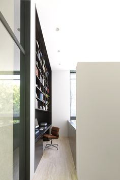 Tobias Partners - Cooper Park House. Technicolor bookcase and office space.