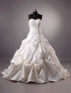 Strapless pick up wedding dresses. Ball gown wedding dresses with pick ups. See other designer #weddingdresses on our main website at www.dariuscordell.com