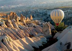 My husband and I took a balloon tour over Cappadoccia, Turkey way back when we were just dating..... It was L.O.V.E.