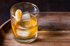 Classic Old Fashioned: 1. Place sugar cube in bottom of a rocks glass.  2. Add  3 dashes Angostura bitters and a splash of water.  3. Crush sugar cube thoroughly with a wooden muddler or strong spoon. Pour in the whiskey, place a few ice cubes in the glass, and stir until well chilled.  4. Garnish with orange peel.