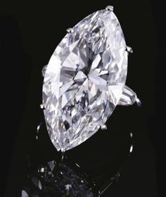 IMPORTANT DIAMOND RING, CARTIER.  Set with a marquise-shaped diamond weighing 22.25 carats, between tapered baguette diamond shoulders, mounted in platinum