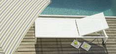 A lounger, an Umbrella and a Pool-ingredients of a Summer cocktail