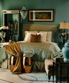 Gold and blue contrasts throughout the room.  Love the colors.  Love the long frame over the bed.
