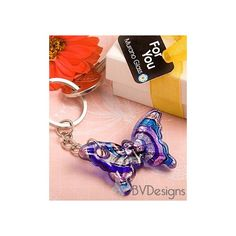 Swirled Murano design glass charm in the shape of a butterfly in a colorful array of bold colors in varying shades of blue, metallic silver, gold and pink tones