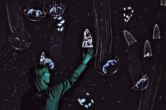 """A bioluminescent jellies """"interactive wall"""" is where visitors can spark jellies and plankton to glow with a wave of their arms at the Monterey Bay Aquarium"""