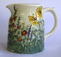 Jenny Bell pottery....MONET'S GARDEN, a mix of Sunflowers, Holyhocks & other flowers