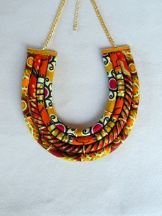 african wax print bib necklace orange and brown by nad205 on Etsy, $30.00