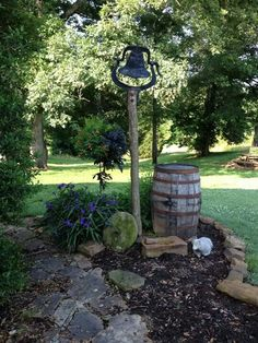 Old whiskey barrel and dinner bell