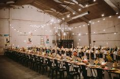 Old Wood Factory Spain Wedding // String twinkle lights inside an industrial space + a colorful tablescape