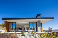 A contemporary home in Park City, Utah, with energy-efficient features like a vegetated roof and a geothermal system. There is also a 40-foot glass wall to take advantage of the mountain views.