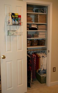 Linen closet organization...love the idea of hanging blankets, throws and tablecloths with pants hangers.