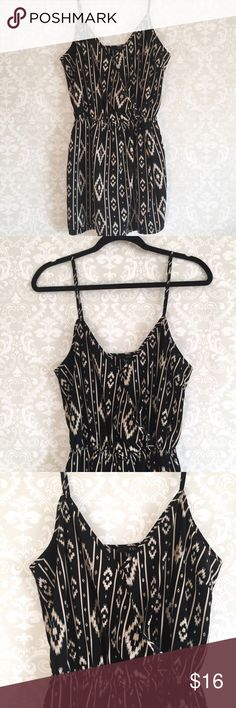 "Black and Tan Printed Romper Black and Tan printed romper with thin adjustable straps and with a snap button closure on the chest area. Has a thin elastic waistband. Thin lightweight material made of 100% polyester. Strap length is 16"". From shoulder to waist is 19"". From pit to pit is 19.5"" across. Waist stretches out to 20"". Length of total romper is 33"". From waist to bottom is 13"" and I nseam is 2.5"". Gently used, excellent condition! Please note: I do not model. Forever 21 Pants…"