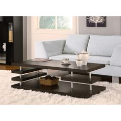With its sleek, modern design, this striking coffee table is the perfect fit for a contemporary space. The table is crafted with shining sil...