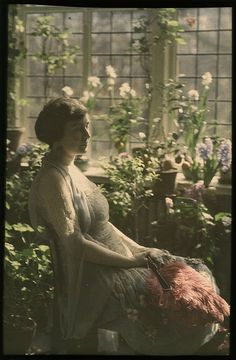Woman in greenhouse,1910,autochrome(early color photography)