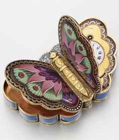 ca. 1820. Piguet & Meylan Combination Music Box, Clock and Snuff box. Butterfly Wings open. Gold and Enamel. made for the Chines Market. Case by George Reymond.