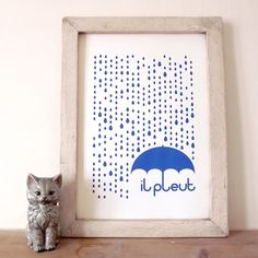 Oh, il pleut! It feels much more cheerful to say its raining in French!  This beautiful raindrops and umbrella design would be a striking featur...