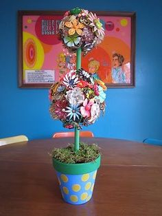 Turn a collection of retro flower pins into an adorable tabletop topiary.