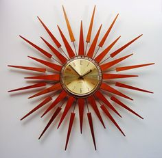 Mid-Century Modern Starburst Wall Clock by Seth Thomas, Starflower Design.  1960s.  Teak Darts and Arrows.. $275.00, via Etsy.