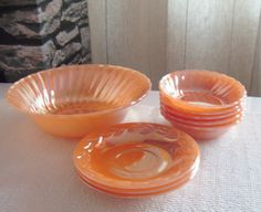 """Vintage Anchor Hocking Fire King Oven safe glass tableware. Mixed set includes: 1 Salad Serving Bowl, 8.4"""" w x 2.6"""" h, 5 Side Salad Bowls, 4.6"""" x 1.4"""" h, and 3 Saucers, 5.6"""". $39.59/9-pcs at DenaBYRiches (UK) on etsy, 10/4/15"""