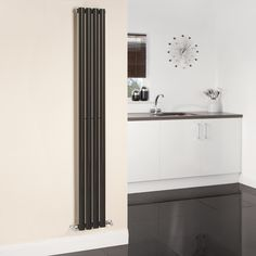 The High Gloss Black Milano Aruba Vertical Designer Radiator Looks Fabulous  In This Monochrome Kitchen.