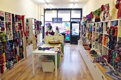 cupboards under cube shelves long table int he middle, you could use if for display and also get some fold up chairs to bring out for workshops Fold Up Chairs, Finding A Hobby, Cube Shelves, Long Shot, Hobby Shop, Yarn Shop, Knitting Accessories, Happy Moments, Vintage Knitting