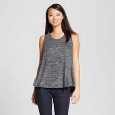 This season's must have is the Women's Snit Swing Tank by Merona™. With cool comfort and total versatility, this women's sleeveless high-low hem blouse will be a favorite.