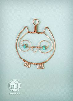 Owl Pendant - necklace hand made with copper wire and teal beads - artsy owl ornament. $7.80, via Etsy.