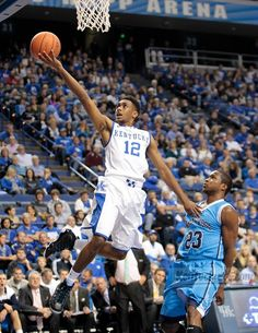 UK guard Ryan Harrow (12) scored past Northwood guard Ra'Shad James (23) during the first half of the Northwood at Kentucky exhibition basketball game at Rupp Arena in Lexington, Ky., on Thursday Nov. 1, 2012.