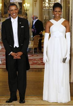 A true vision: Michelle wore a white Tom Ford halter neck dress accessorized with opera gl...