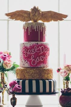 Pink, gold and black tattoo-inspired cake with heart topper by Tattooed Bakers. Alternative wedding cake idea
