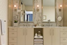 Love the medicine cabinets on the side.  I would carry the marble on the floor.