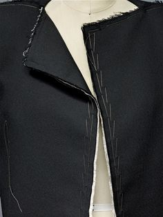 House of Lanvin (French, founded 1889), Alber Elbaz (Israeli, born Morocco, 1961). Jacket(detail), spring/summer 2015, Prêt–à–Porter. Machine–sewn black technical stretch cotton and white cotton canvas, decorative hand–topstitching with silver metal thread. Photo © Nicholas Alan Cope. #ManusxMachina #CostumeInstitute