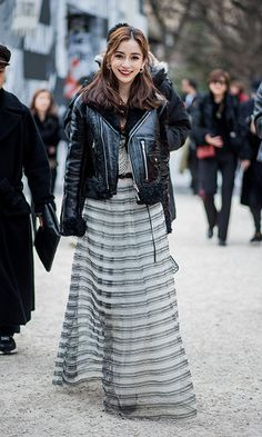 Chinese actress Angelababy rocked a leather jacket over a striped dress as she made her way to the shows.