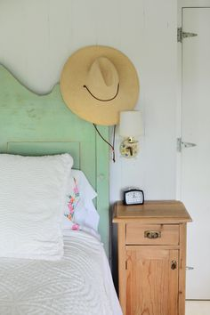 Put hats above your headboard...or even better, on pegs across the top of the ceiling.