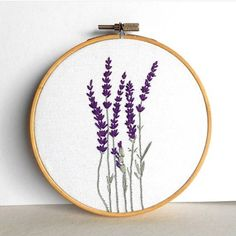 "Lavander stems hand embroidered in a 5"" (13 cm) wooden hoop.  The wooden hoop have a brass screw on top, so it's ready to be hang on the wall or stand alone on shelves.  .  .  .  .  #floralembroidery #wip #handembroidered #contemporaryembroidery #flower #lavanda"