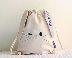 This little bunny bag is very cute and comes with a surprise under one of his ears - his new best friends name! The bag is X and is made using a lovely heavy weight cotton with a twisted cotton rope cord. French seams give extra strength and dura Bunny Bags, Bunny Bunny, Easter Bunny, Diy Backpack, Nature Crafts, Kids Bags, Cotton Rope, Backpacker, Treat Bags