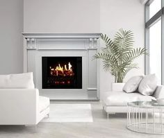 Electric fireplace runs on ethanol and burns clean and smoke-free. An interesting idea for something new to add to your wall decor. #electricfireplace #fireplaceideas #fireplace #homeideas Realistic Electric Fireplace, Wall Mount Electric Fireplace, Fireplace Pictures, Real Fire, Fire Prevention, Electric Fires, Cleaning Dust, Fireplace Inserts, Cool Walls