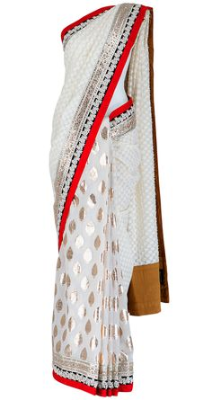 looks like i'm falling in love with the white sarees...