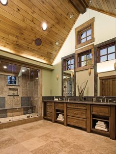 The vaulted wood panel ceiling design is a wow-factor in this beautiful craftsman-style bathroom.