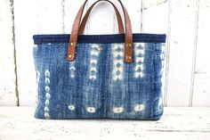 INDIGO CLOTH TOTE BAG - This bag is made from very old, authentic Indigo cloth dating back to the late 19th Century. This cloth came from West Africa where these cloths were hand woven and hand dyed using the natural dye from the Indigo plant. These textiles signified wealth, abundance and fertility. Today, Indigo cloth is highly sought after for its beauty, uniqueness and history, and they are works of art in themselves. The cloth is 100% cotton.  The bags lining is made from vintage soft…