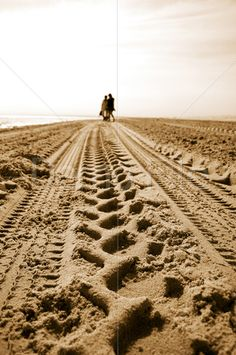 Royalty Free Stock Photos and Images A Mother & Daughter Stroll On Tyre Tracking Leading Up A Sandy Beach. Tyre Tracks, Tire Marks, Inktober, Railroad Tracks, Random Stuff, Royalty Free Stock Photos, Landscapes, Surface, Texture