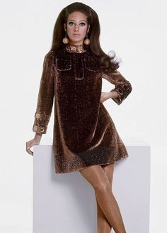 Marisa Berenson wearing a bronze-dore dinner dress by Eloise Curtis for David Styne and earrings by Regina Novelty. Vogue 1967. Photos by Gianni Penati