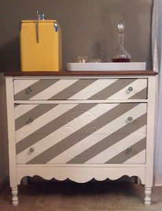 Antique chest with diagonal stripes brings a modern touch to this classic piece.