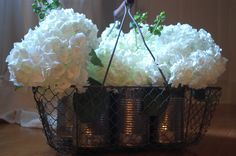 old basket, tin cans.....perfect centerpiece