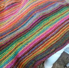 Garter stitch knitted blanket in Noro Kureyon yarn. Free pattern.