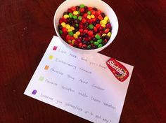 The guests each chose 3 skittles not knowing the reason.  This is a fun game regardless of how well you know eachother, but also great as an icebreaker game.  Red = Last book they read, Yellow= Embarrassing Moment, Orange= Favorite Thing About Summer or Something Fun They Were Doing This Summer, Green= Favorite Vacation or Dream Vacation, Purple=Someone you Admire or Look up to and Why?