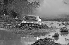 AFRICA, KENYA - Safari Rally Car no 2, Peugeot 504 coup, in flooded roads near Mathatani in Eastern province on its way to Nairobi at the end of the first leg in 1978.