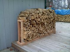 "Wood rack... we built this and added a ""basket"" on the side for the small fire starter scraps and twigs, love it!!"