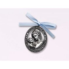 Beautiful Madonna and child crib medal to stay with your child as they sleep!