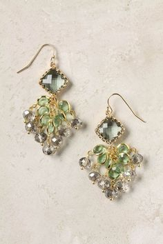 """Gallatin Earrings    Seven jeweled strands drip from their sparkling stone source.        14k gold plated metal, glass, resin      1.75""""L, 0.75""""W"""